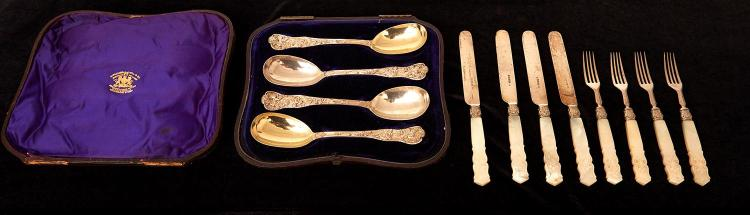 A SET OF FOUR VICTORIAN BOXED BACCHANALIAN STERLING SILVER SERVING SPOONS BY H&H LIAS, LONDON 1875