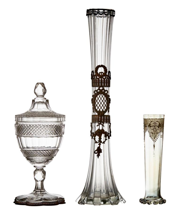 A FRENCH GILT METAL MOUNTED BUD VASE, WITH CUT CRYSTAL JAR AND COVER AND ENAMELLED VASE, CIRCA 1900