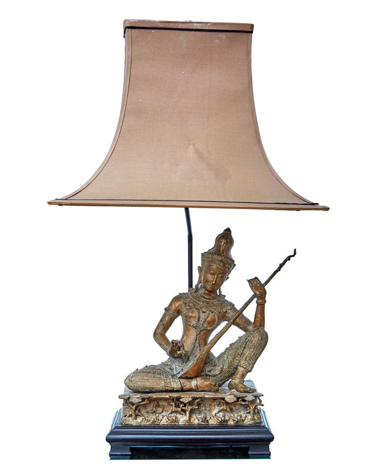 A THAI GILT COPPER FIGURAL LAMP WITH SILK SHADE