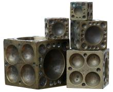 A SET OF FIVE BRONZE GRADUATED JEWELLERS BLOCKS BY