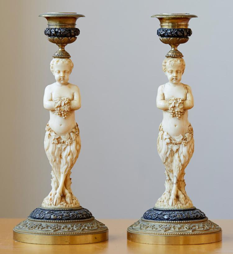 A PAIR OF FRENCH 19TH CENTURY IVORY AND GILT BRONZE MOUNTED CANDLESTICKS, POSSIBLY DIEPPE