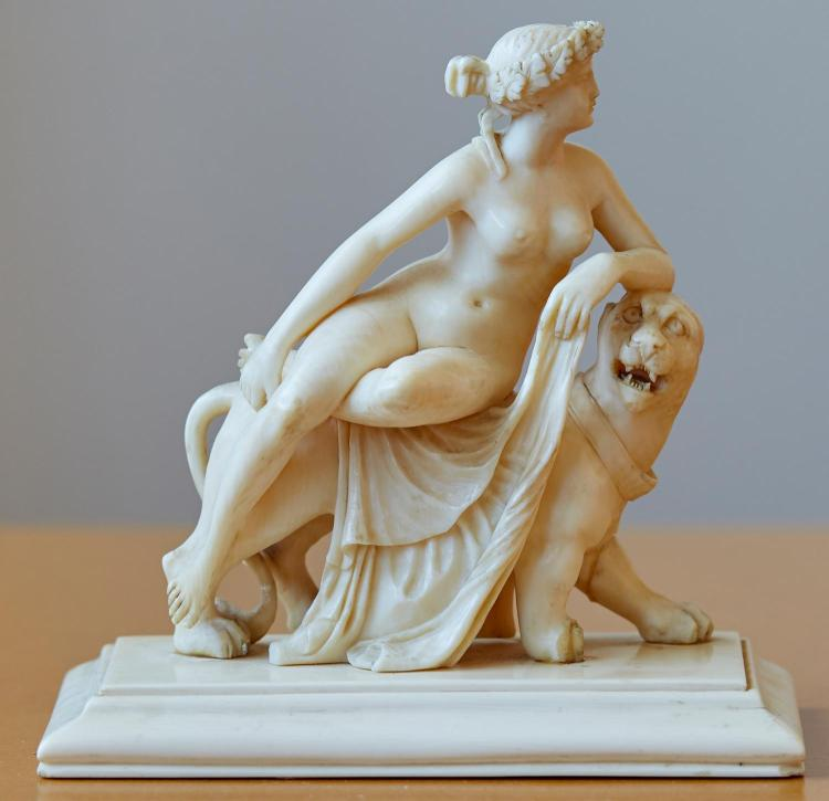 A FRENCH IVORY FIGURE AFTER GUILLAUME (WILLEM) GEEFS, BELGIAN 1805-1883 ''LION IN LOVE'', PROBABLY DIEPPE