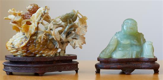 A YELLOW JADE GROUP CARVING AND A JADE CARVED BUDDHA, SECOND HALF OF THE 20TH CENTURY