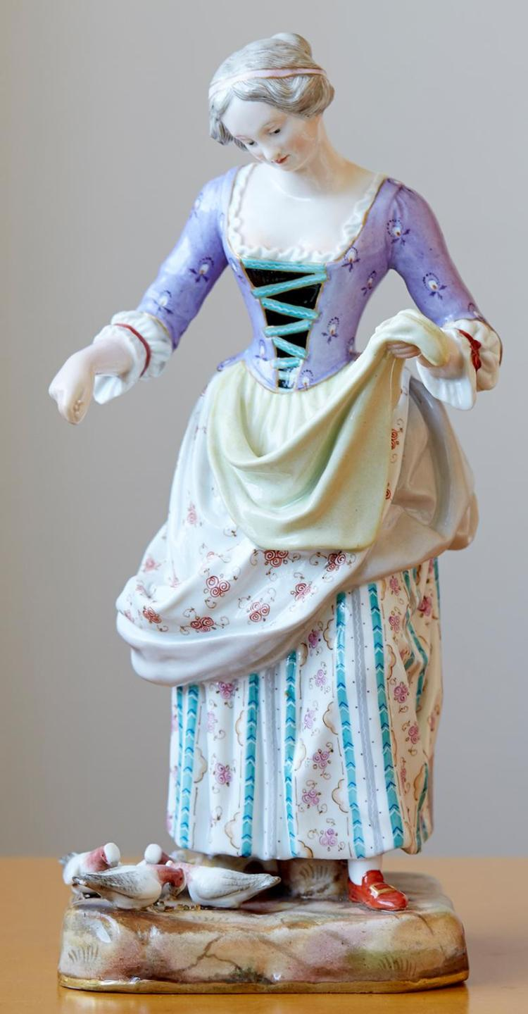 A MEISSEN PORCELAIN FIGURE, ''FEEDING PIGEONS'', LATE 19TH CENTURY