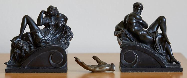 A PAIR OF BRONZE BOOK ENDS