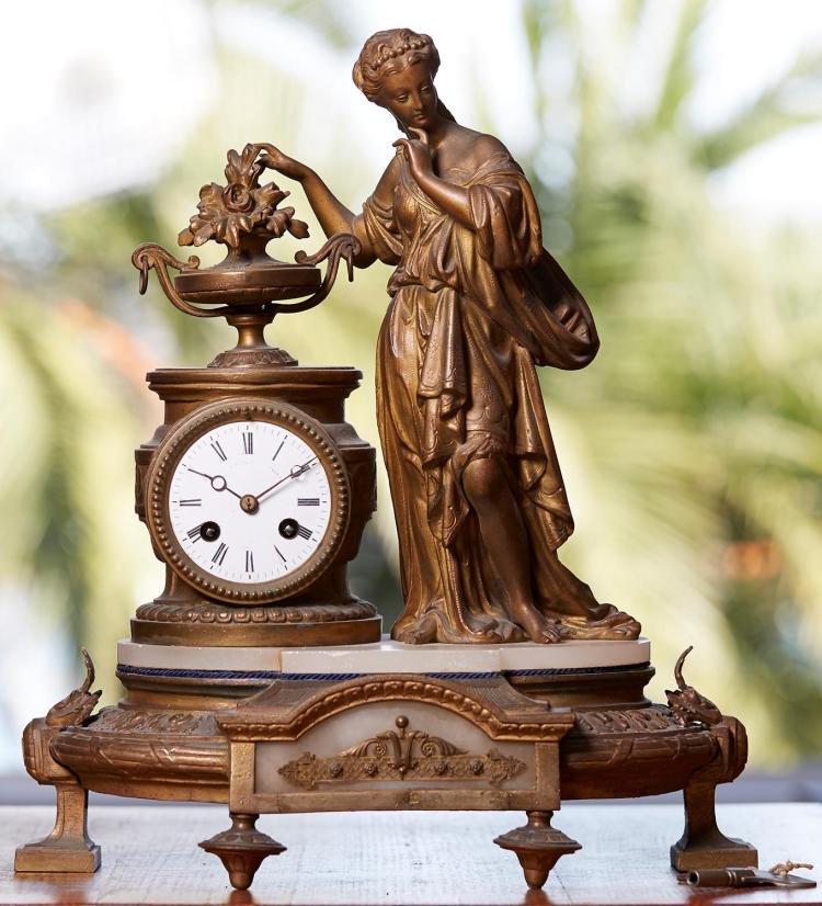 A FRENCH GILT BRONZE FIGURAL CLOCK, LATE 19TH CENTURY Depicting a classical figure with campana and flowers, 40cm high