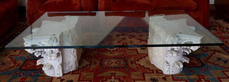 GLASS TOPPED COFFEE TABLE WITH CARVED STONE CORINTHIAN CAPITAL BASE
