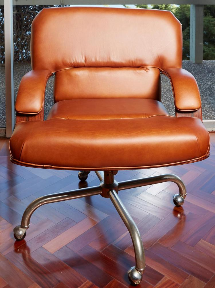 A ROSEWOOD AND LEATHER SWIVEL OFFICE CHAIR, CIRCA 1970''S