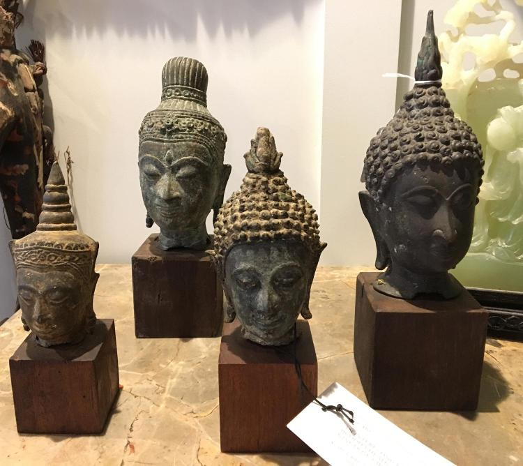 AN INTERESTING GROUP OF THAI BRONZE BUDDHA HEADS, SOME SUKHOTHAI KINGDOM, CIRCA 14TH/15TH CENTURY AND LATER