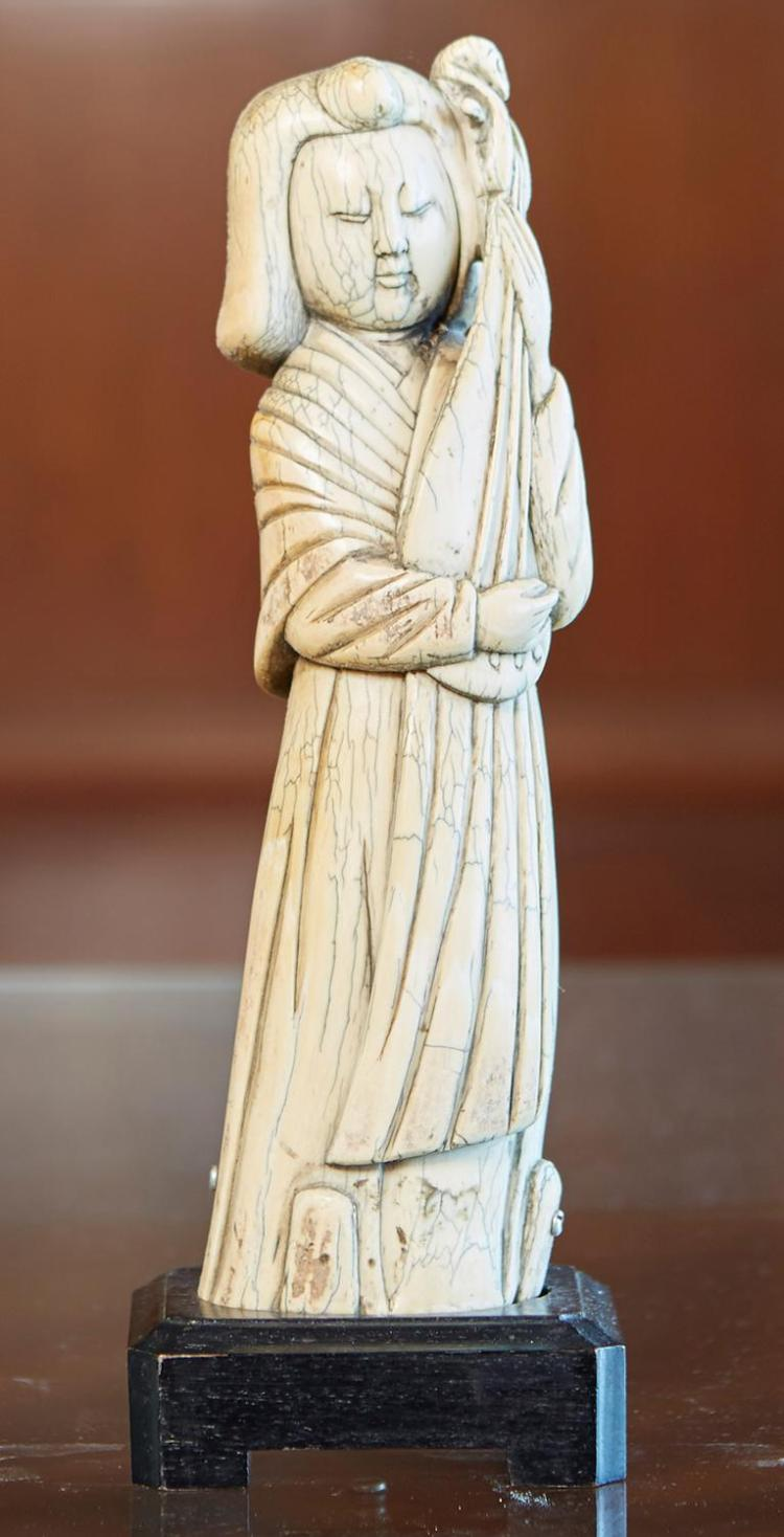 A CHINESE MING IVORY FIGURE OF A FIGURE PLAYING THE PIPA, POSSIBLY MING