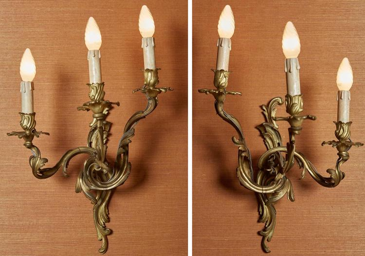 A PAIR OF FRENCH 19TH CENTURY ORMOLU THREE BRANCH WALL SCONCES