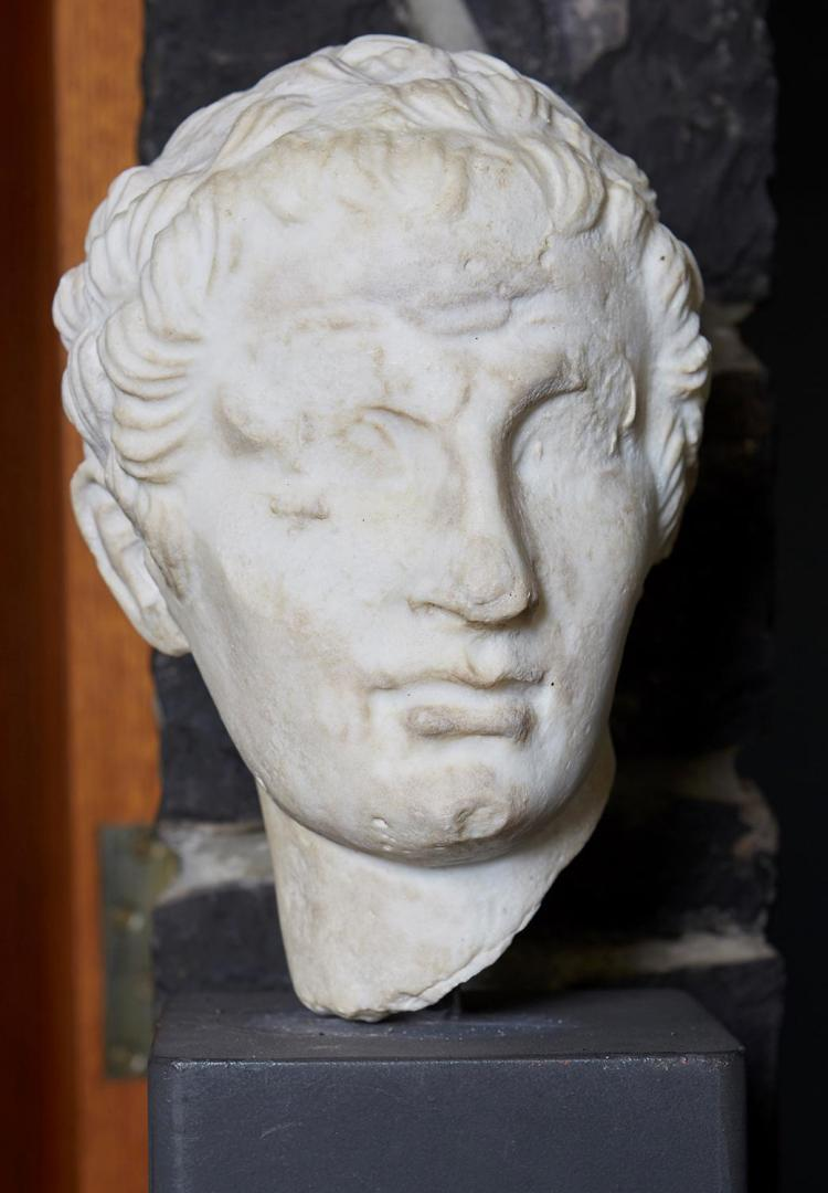 A MARBLE BUST, POSSIBLY ROMANESQUE