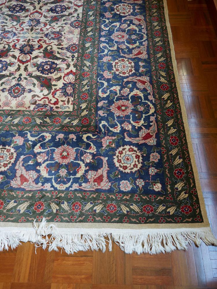 A FINE HAND KNOTTED TURKISH HEREKE SILK CARPET, SIGNED