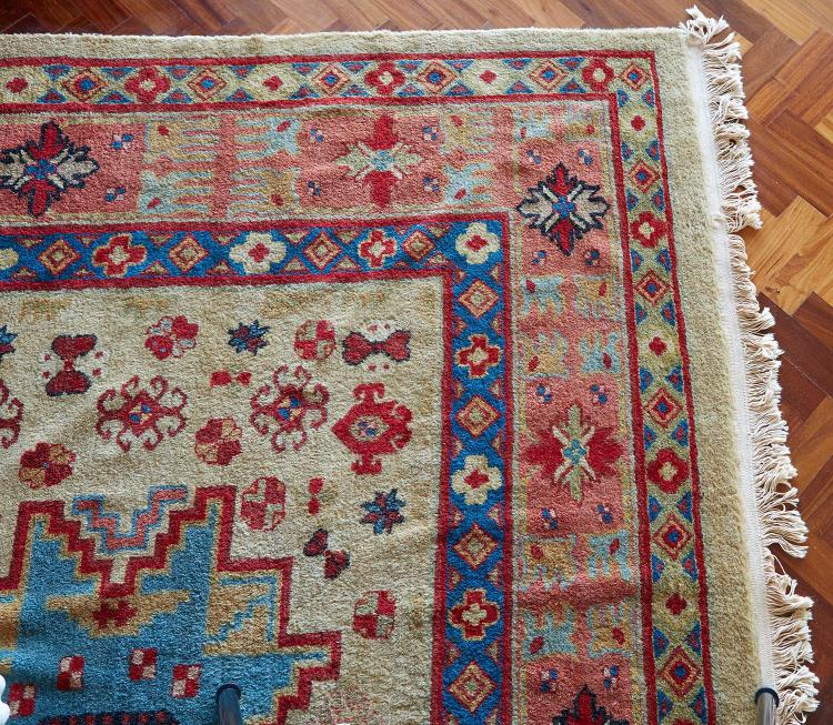 A TURKISH CARPET, HAND KNOTTED WITH THICK PILE