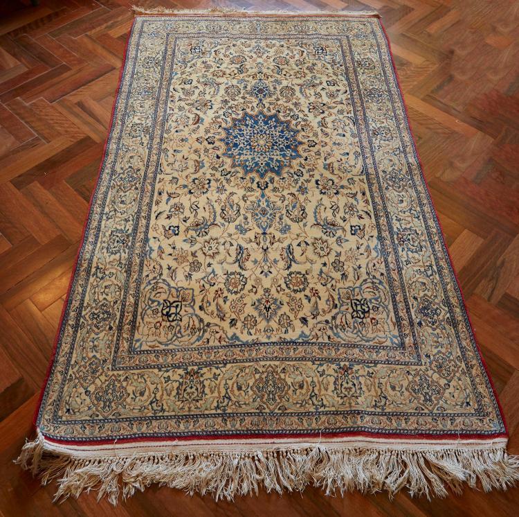 A FINE PERSIAN SILK CARPET