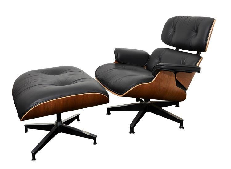 A CHARLES AND RAY EAMES CHAIR AND OTTOMAN MANUFACTURED BY HERMAN MILLER, 670 & 671