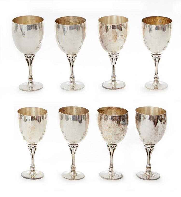 A FINE SET OF EIGHT GEORG JENSEN STERLING SILVER WINE GOBLETS BY HARALD NIELSEN