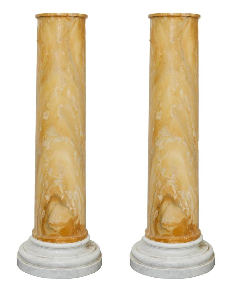 A PAIR OF YELLOW MARBLE PEDESTALS ON WHITE MARBE STEPPED BASES