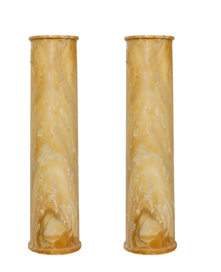 A PAIR OF YELLOW MARBLE PEDESTALS
