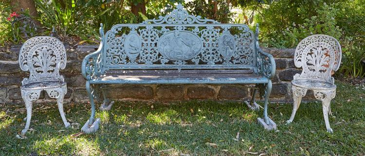A VICTORIAN CAST IRON BENCH BY COALBROOKDALE, IN A RARE ''MEDALLION DESIGN''