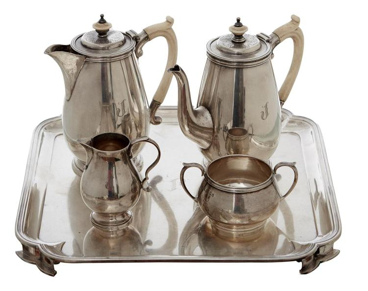 A STERLING SILVER FOUR PIECE BACHELOR COFFEE SERVICE WITH MATCHED TRAY, BY HARDY BROTHERS AND EDWARD BARNARD & SONS