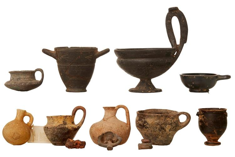 A COLLECTION OF TWELVE ROMAN ERA CERAMIC ANTIQUITIES