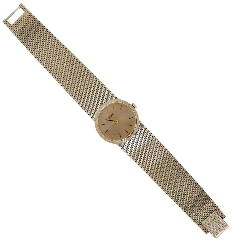 A LADIES PIAGET GOLD WRISTWATCH