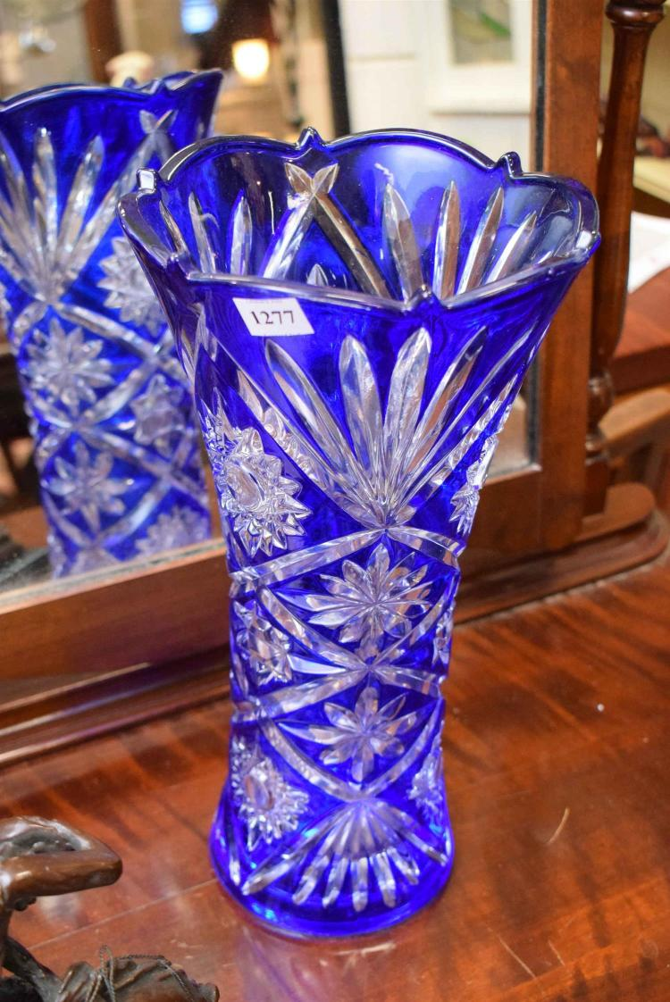 a decorative blue glass vase. Black Bedroom Furniture Sets. Home Design Ideas