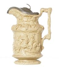 A MID 19TH CENTURY ENGLISH STONEWARE CLARET JUG WITH PEWTER LID, CHARLES M. BIGH. Elaborately moulded with a Bacchanalian scene, 30....