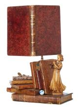 AN UNUSUAL BIBLIOPHILE TABLE LAMP. Designed by a Parisian artist. 51cm high