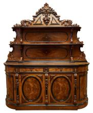 A FLEMISH WALNUT CARVED AND PARTIALLY EBONISED BUFFET, CIRCA 1860. Featuring walnut panels, 260cm high, 223cm wide, 56 cm deep