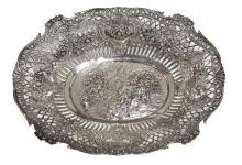 A PIERCED CONTINENTAL SILVER BASKET. Featuring romantic scene. 7.5cm high, 35.5cm wide, 36.5cm deep, 711 gms silver