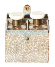 TWO ART DECO ENGLISH PERFUME BOTTLES, WITH SHAGREEN AND STERLING SILVER TOPS, IN FAUX SHAGREEN LEATHER CASE. The case 11.5cm high, 9...