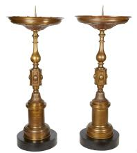 A PAIR OF FRENCH BRASS TORCHERES, CIRCA 1850S. 163cm high, 64.5cm diameter (approximately)