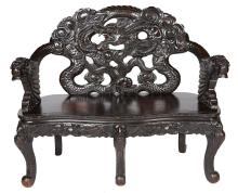 A 19TH CENTURY JAPANESE EXPORT HARDWOOD CARVED HALL BENCH. 102cm high, 116cm wide, 51cm deep