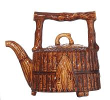 A 19TH CENTURY POTTERY TEAPOT, POSSIBLY BENDIGO POTTERY. Modelled with a branch handle. 19cm high