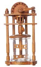 AN ANTIQUE FRENCH FRUITWOOD BUTTER CHURNER.