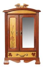 A UNIQUE MODEL OF A MINIATURE ARMOIRE IN THE ARTS AND CRAFTS MANNER.
