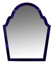 AN ART DECO MIRROR WITH A BLUE GLASS TRIM.