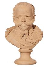 A TERRACOTTA BUST OF A RUSSIAN OFFICER, CIRCA 1900, SIGNED TO BASE.