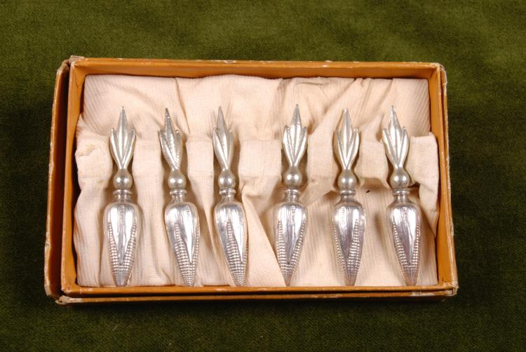 6 Sterling Handle Corn Holders.