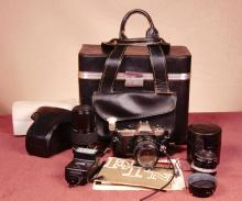 Nikon FM10 Camera with 3 Lenses, Flash and Case.