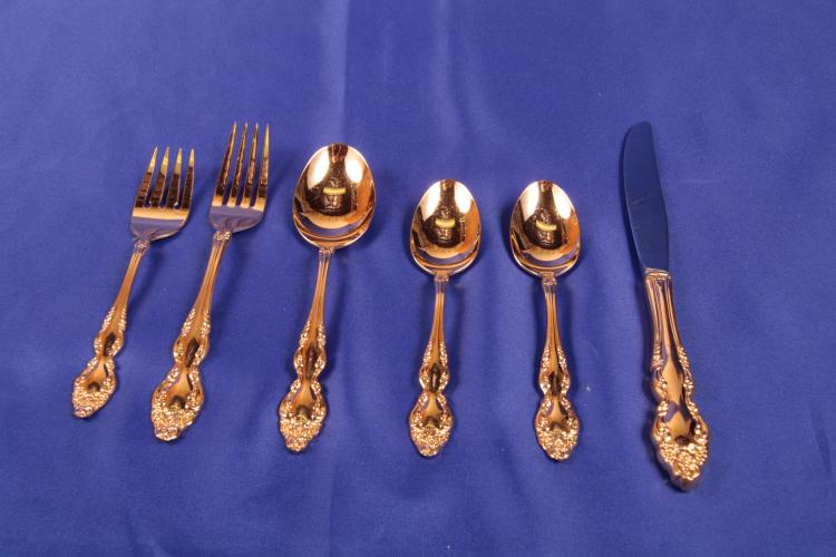 72 pieces. 1881 Rogers. Gold electroplate by Oneida.