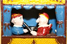 Antique cast iron Punch and Judy bank not a reproduction