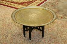Antique hand hammered brass tray table with original hand carved stand
