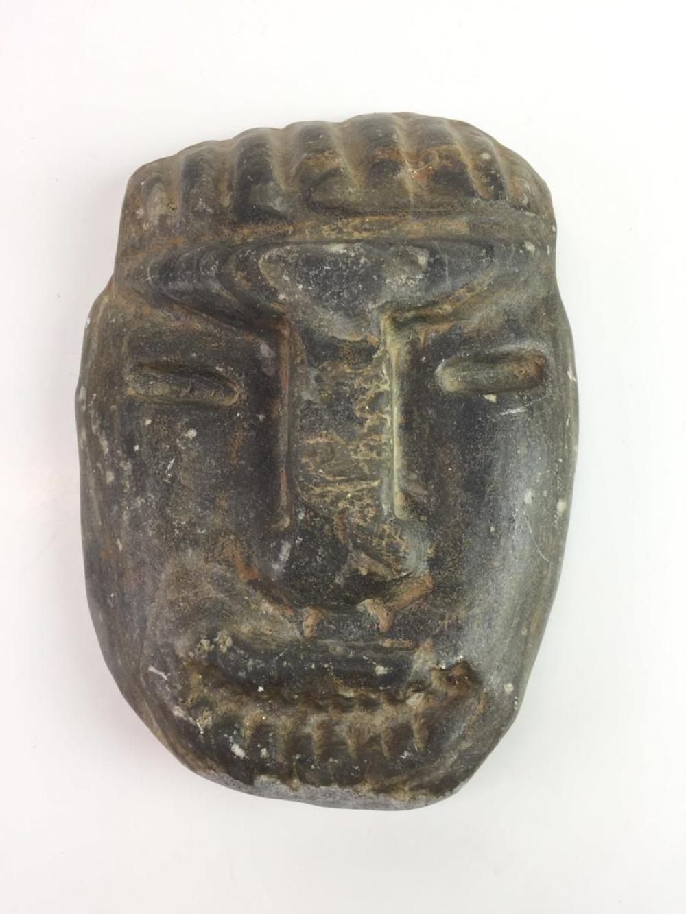 African tribal carved stone head