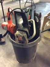 Bucket with Chainsaws and Hedge Clippers
