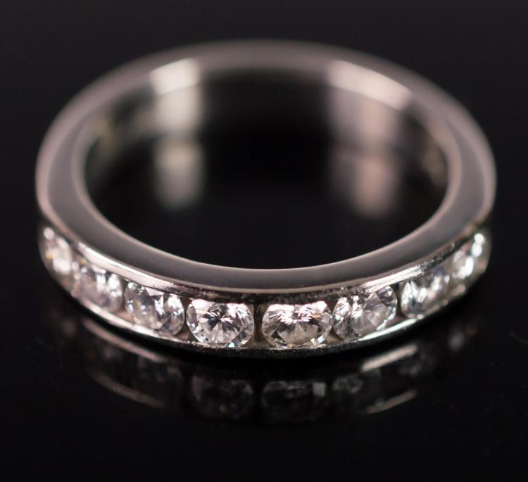 Platinum Diamond Ring, 8 Channel Set Stones