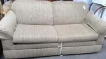 Tan Sleeper Love Seat