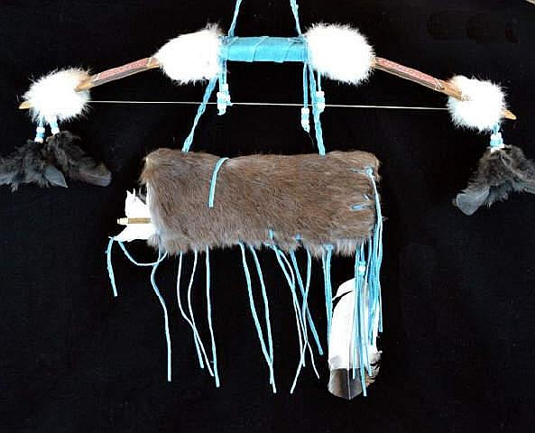 Native American hanging bow with fur quiver